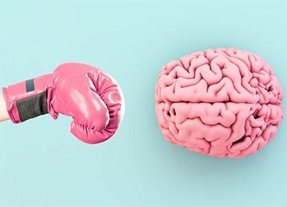 Team Werbung vs. Hirn - Blog - Content Bild - Boxhandschuh trifft Gehirn